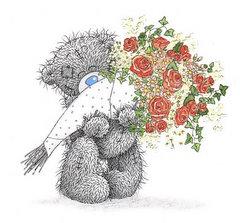 Misiu trzyma bukiet róż