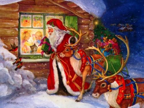 Mikołaj przy domku z prezentami