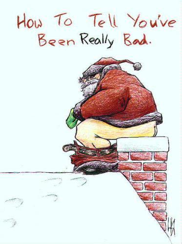 Mikołaj siedzący na kominie